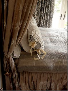 """The master bedroom is the fulfillment of the owner's vision.  She designed and hand printed all the bed fabrics!!!"""