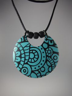 Turquoise silkscreened polymer clay necklace by Annie Jacobi Jewelry.