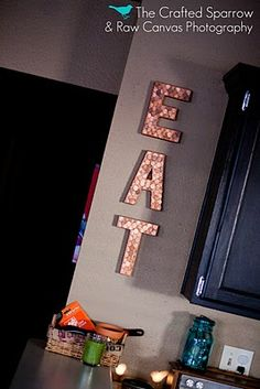 Pennies on letters. Easy copper art. I think I want to make this...