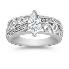 Vintage Diamond Engagement Ring with Pave Setting. Showing with Marquise cut diamond. Available with your choice of ruby, diamond or sapphire center stone.