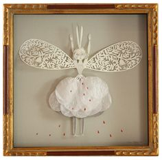 Beautiful tiny intricate paper cuts by a girl at http://elsita.typepad.com/allaboutpapercutting/.