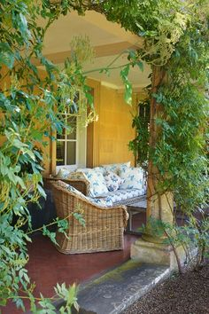 Garden Terrace With Woven Wicker Seating at Bowood House in garden room design ideas, English country house terrace with climbers.