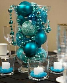 Turquoise Christmas bulbs in a vase as table decor. 50 Most Beautiful Christmas Table Decorations Teal Christmas, Beautiful Christmas, Simple Christmas, Christmas Wedding, Christmas Holidays, Christmas Bulbs, Christmas Mantles, Victorian Christmas, Vintage Christmas