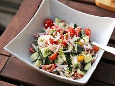 A quick chopped salad of tomatoes, cucumbers, red onion, and feta cheese in a light lemon, olive oil, and herb dressing.