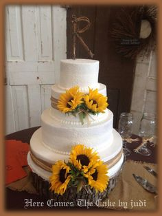 Sunflower Wedding Cake.  Make 3 tier and add green ribbon.