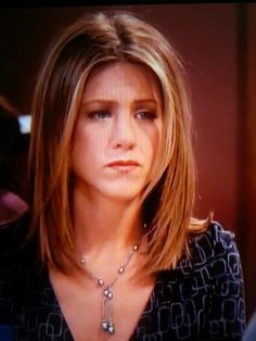 Jennifer Aniston as Rachel Green in Friends with shoulder length straight hair.
