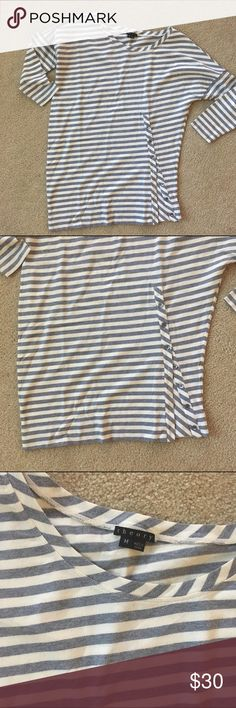 Theory asymmetrical striped shirt Get this super cute n' casual striped 3/4 sleeve shirt. It's perfect for running errands or for a laid back office. Theory Tops