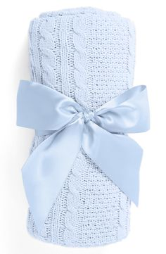 This precious blue cable knit blanket comes perfectly wrapped with a sweet…