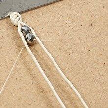 Læderarmbånd med facetperler og fiskesnøre