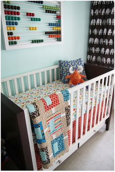 abacus above crib. ingenius! i would have hung a little lower so little einstein could play quietly while waiting for sleepy mama to get up and get him out of bed.