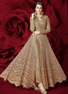 Beige Heavy Embroidered Pant Style Anarkali Suit features a gorgeous net top alongside a silk inner and bottom. A net dupatta completes the look. Embroidery work is completed with zari, thread, and stone. Bridal Anarkali Suits, Pakistani Formal Dresses, Pakistani Wedding Outfits, Indian Gowns Dresses, Indian Fashion Dresses, Dress Indian Style, Indian Designer Outfits, Stylish Dresses For Girls, Wedding Dresses For Girls