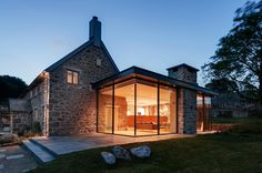 Wide Glass Wall With Fantastic Lamps Decoration As One Of The Modern Extension To The Old Stone House Along With Stone Terrace And Green Court The Modern Extension to the Old Stone House Modern Farmhouse Exterior, Rustic Farmhouse, Farmhouse Style, Urban Farmhouse, Farmhouse Contemporary, Contemporary Building, Contemporary Kitchens, Farmhouse Plans, Contemporary Bedroom