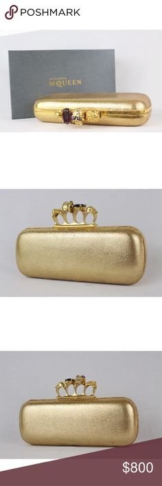 "ALEXANDER MCQUEEN gold leather skull clutch -Impossibly cool and badass clutch from late designer Alexander McQueen -Features a row of skull and purple stone knuckles  -Made of supple gold leather  -Made in Italy -A true collector's item, sold out everywhere -Has code : 226177 / 000926  Approx Measurements  -Height: 4"" -Width: 10"" -Depth: 2""   Condition -In amazing condition, includes storage box, shows signs of wear inside the knuckle part where the gold has eroded. Also sides clutch has…"