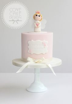 Pink girls birthday cake with angel cake topper