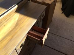 Secured power strip in drawer, cut hole in back of buffet and drawer to hide cord and allow buffet to be pushed up against wall.