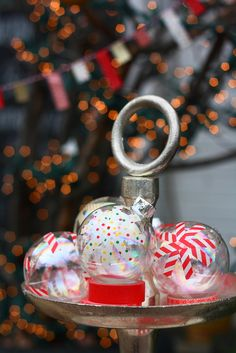 Design your own ornaments: Transform clear plastic balls with washi tape.