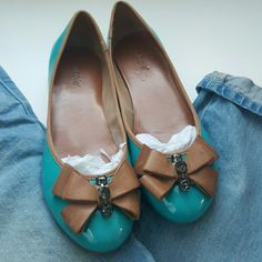 7.5 Nicole bow flats Great patent flats in a teal shade with tan trim and bow. Rhinestone accents on bow, slight wear on bow, pictured. Worn only a few times, very little wear on bottoms. Boyfriend jeans also for sale, shop my closet! nicole Shoes Flats & Loafers
