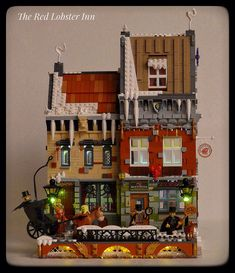 ~ Lego Mocs Holidays ~ Christmas ~ monstrophonic built the three story Red Lobster Inn. The inn is set in a past time (perhaps the 1800s?) during the holiday season. The build is also very charming with its many snow details.