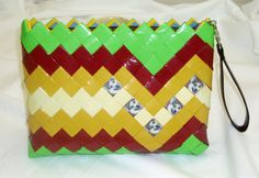 This designer candy wrapper clutch is a smaller version of the Melinda Slim Clutch.  This design accommodates 6 photos as shown, order the bag with or without photos.  Of course, we added a zipper and removable strap.  It has easy access for your belongings. $60.00