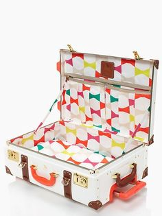 This is Kate Spade. But could upcycle and old vintage suitcase with some fresh fabric ...?