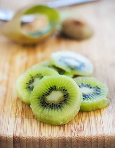 How to peel a Kiwi IN UNDER 10 SECONDS! (cut the ends off with a sharp knife and then run a large dinner spoon between the skin and the fruit. Then SHAKE out!) AMAZING!