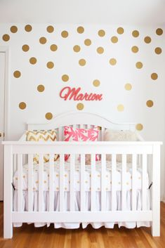 Gold Polka Dot Accent Wall - looks fab paired with coral in a nursery!