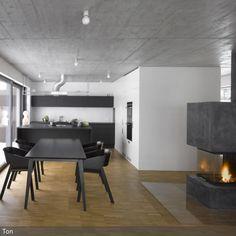 Sehr edel kommt der moderne Essbereich mit Kamin daher. Küchenzeile, Tresen und die Essgruppe sind aufeinander abgestimmt. Die Decke in Beton-Optik und die dunkelgrau…