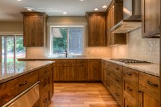Kitchen, knotty alder cabinets, warming drawer, white oak floors