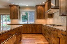 Kitchen, knotty alder cabinets, warming drawer, white oak floors