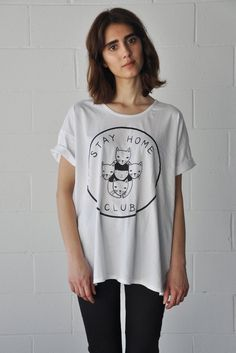 Designed by Olivia Mew Black print on white tee Scoop neck, short sleeves, slouchy fit Made in the USA & Canada especially for Stay Home Club. Soft 100% co