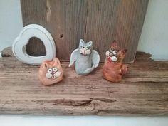 Gattini in ceramica