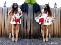 Red roses on a white dress