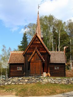 Garmo stave church originally came from Garmo in Lom in Oppland county. It was built circa 1150 on the site of a previous church believed to have been built in 1021 by a Viking chieftain. The church consists of 17th and 18th century inventory with a pulpit from Romsdalen. In 1730, it was expanded into a cruciform church in the timber.