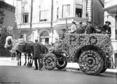 This Portland Fire Department hose wagon is decorated for the 1908 Rose Festival.