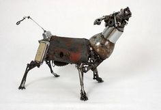 24 Cars blue Sky: Old car parts salvaged into beautiful sculptures
