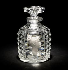 An Apsley Pellatt perfume bottle and stopper of Royal interest, circa 1817 Of flattened oval shape, reserved with a panel containing a sulphide inclusion of a portrait bust of Princess Charlotte flanked by gadrooned panels and a diamond panel to the back, the stopper with a petal-cut rim. The Pellatt Family were of French Huguenot Descent