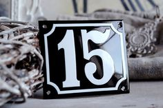 This custom house number is carefully handcrafted using genuine porcelain enamel and stencils. I prepare the art work in my studio and present it to