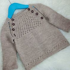 Blaer, a baby sweater, by Dagbjort Orvarsdottir, pattern available in English on Ravelry.