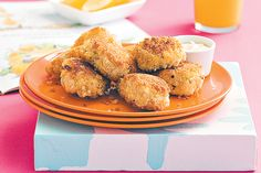 Kids will love these homemade chicken nuggets. Served with oven-baked wedges and salad, they make an easy meal.