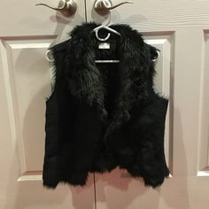 Faux fur black vest. Faux fur and suede vest by Jennifer Lopez. Comfortable and chic and only worn once. In perfect condition. Jennifer Lopez Jackets & Coats Vests