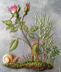 floral embroidery with a snail                                                                                                                                                      More