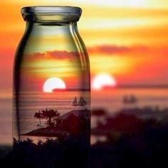 View of sailboats & Sunset thru glass jar art