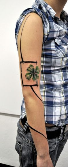 Four leaf clover tattoo.  An awesome one.    http://pinterest.com/treypeezy  http://OceanviewBLVD.com