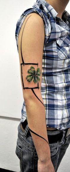 Four leaf clover tattoo.  An awesome one.    http://pinterest.com/treypeezy  http://OceanviewBLVD.com