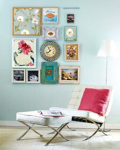 Gallery wall - eclectic mix but the rectangular shape ties it together well.