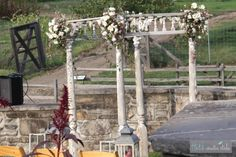 designed by hatch creative studio - Salvage Chuppah or Arbor  Designed with salvaged porch posts and railings Structure is free standing