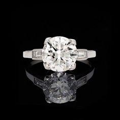 The platinum engagement ring centers a GIA 2.52 carat round brilliant-cut diamond, F color and SI1 clarity. #GIA #roundbrilliantcut #platinum #solitairering