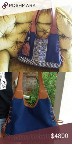 COMING SOONLucky Brand Purse Price will be $58EUC-Navy this canvas type fabric, embroidered pattern on front, vegan leather trim/handles/tassel....more info to come. Lucky Brand Bags Hobos