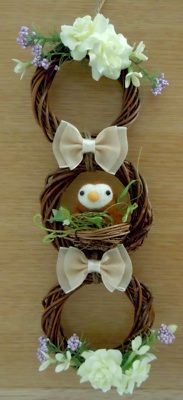 three stacking grapevine wreaths with baby sparrow in a nest