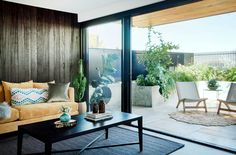 The west-facing living room of this climate-sensitive Perth home enjoys soft light, rather than harsh sunlight and extends onto a courtyard with philodendrons, grasses and succulents. Photography: Jody D'Arcy   Story: Australian House & Garden